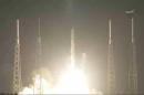 In this framegrab provided by NASA, the SpaceX cargo ship lifts off, rocketing toward the International Space Station Sunday Sept. 21, 2014. The company launched its unmanned Dragon capsule from Cape Canaveral, Florida, early Sunday aboard a Falcon rocket. It's carrying more than 5,000 pounds of station supplies for NASA, including a 3-D printer, the first one bound for orbit. (AP Photo/NASA TV)