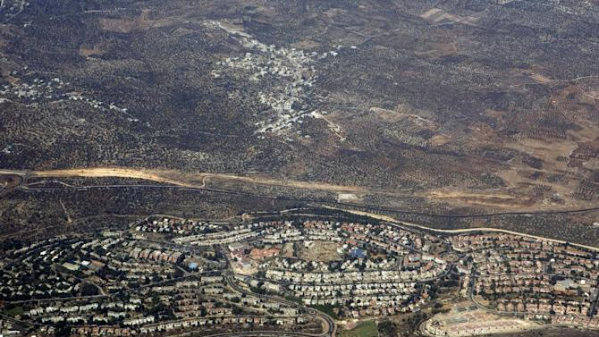 """FILE - In this Sept. 20, 2010 aerial file photo, taken through the window of an airplane, the West Bank Jewish settlement of Ariel is seen. From 2014, Israeli authorities must guarantee that all EU funding and cooperation projects are conducted within Israel's pre-1967 border and not in east Jerusalem, the West Bank or Golan Heights. A senior Israeli official is condemned the European Union's new directive banning EU dealings with settlements as """"worrying"""" and counterproductive to peace talks. (AP Photo/Ariel Schalit, File)"""