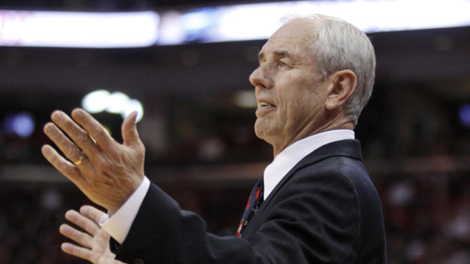 UNC-Asheville coach Eddie Biedenbach reacts to a call during the first half of an NCAA college basketball game against Ohio State in Columbus, Ohio, Saturday, Dec. 15, 2012. Ohio State won 90-72. (AP Photo/Paul Vernon)