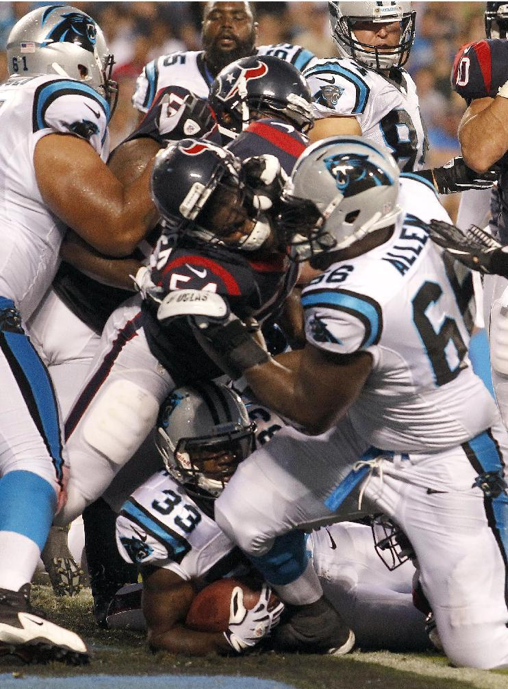 RETRANSMISSION FOR ALTERNATE CROP - Carolina Panthers' Tauren Poole (33), bottom, scores a touchdown against the Houston Texans during the first half of a NFL preseason football game in Charlotte, N.C., Saturday, Aug. 11, 2012. (AP Photo/Bob Leverone)