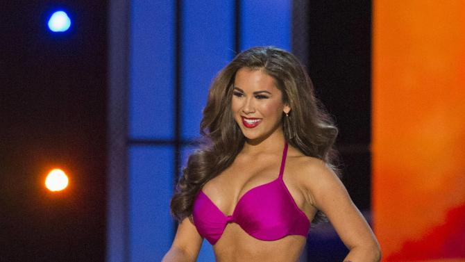 Miss Texas Monique Evans sports a swimsuit during the final 2015 Miss America Competition in Atlantic City, New Jersey