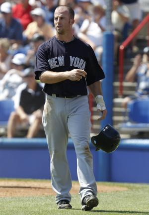 New York Yankees' Brett Gardner tosses his helmet after he was thrown out at the plate in the third inning of the Yankees' 6-5 loss to the Toronto Blue Jays in their spring training baseball game at Florida Auto Exchange Stadium in Dunedin, Fla., Friday, March 18, 2011.  Gardner left the game in the fourth with a bruised shin, an injury he sustained in Thursday night's game against the Tampa Bay Rays. (AP Photo)