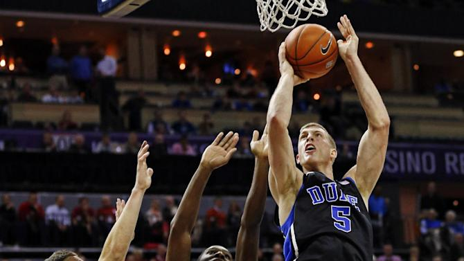 Duke's Mason Plumlee, (5) shoots over Davidson's De'Mon Brooks (24) and JP Kuhlman, left, during the first half of an NCAA college basketball game in Charlotte, N.C., Wednesday, Jan. 2, 2013. (AP Photo/Chuck Burton)