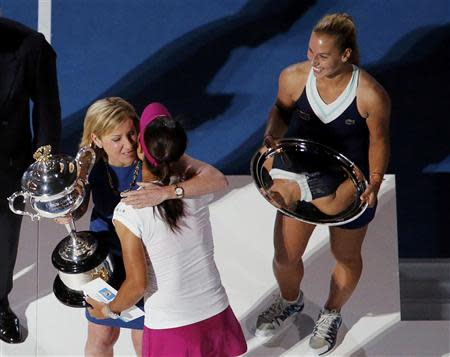 Tennis great Chris Evert of the U.S. presents Li Na of China with the Daphne Akhurst Memorial Cup after she won the women's singles final match against Dominika Cibulkova of Slovakia at the Australian Open 2014 tennis tournament in Melbourne