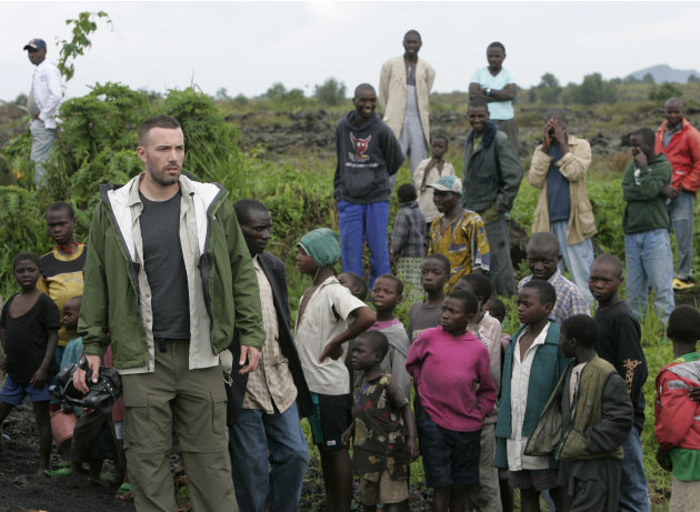 FILE - This Nov. 19, 2008 file photo shows actor/director Ben Affleck walking through a camp for displaced people near Kibati just north of Goma in eastern Congo. Affleck is  managing to live a relati