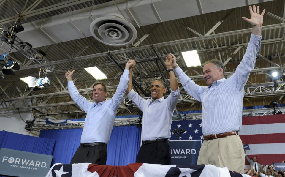President Barack Obama, accompanied by Sen. Mark Warner, D-Va., left, and Virginia Democratic candidate, former Virginia Gov. Tim Kaine, right, take part in a campaign event at Green Run High School in Virginia Beach, Va., Friday, July 13, 2012. Obama is spending the day in Virginia campaigning. (AP Photo/Susan Walsh)