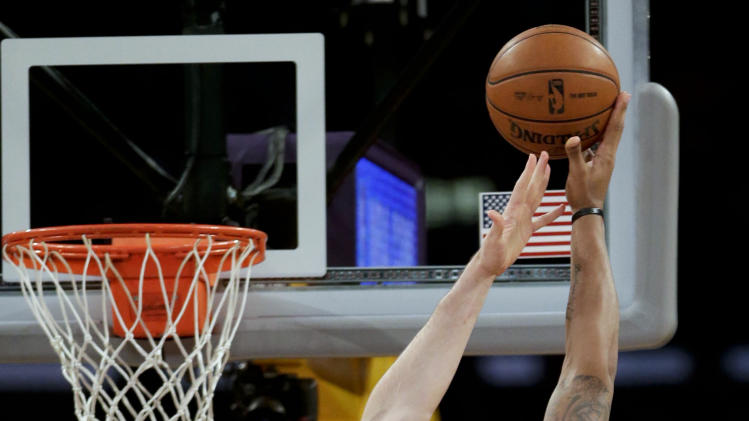 Los Angeles Lakers' Pau Gasol, left, of Spain, tries to block a shot by Houston Rockets' Greg Smith during the first half of an NBA basketball game in Los Angeles, Wednesday, April 17, 2013. (AP Photo/Jae C. Hong)