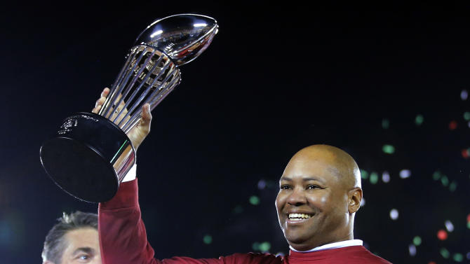Stanford head coach David Shaw lifts the trophy following their 20-14 win over Wisconsin in the Rose Bowl NCAA college football game, Tuesday, Jan. 1, 2013, in Pasadena, Calif. (AP Photo/Jae C. Hong)