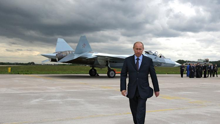 FILE - In this Thursday, June 17, 2010 file photo, Russian Prime Minister Vladimir Putin walks after inspecting a new Russian fighter jet after its test flight in Zhukovksy, outside Moscow, Russia. Putin, who is running to reclaim presidency in March 4 election, laid out his vision of military modernization in an article published Monday, Feb. 20, 2012 in the government daily Rossiyskaya Gazeta. (AP Photo/RIA Novosti, Alexei Druzhinin, Government Press Service, File)
