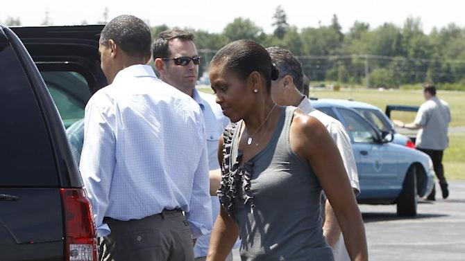 FILE - This July 16, 2010 file photo shows first lady Michelle Obama arriving with President Obama at Hancock County Bar Harbor Airport in Trenton, Maine. Michelle Obama has proven her fashion savvy time and time again since she was introduced to the country as first lady on Inauguration Day 2009. In the past four years she has adeptly walked the line between directional fashionista and everywoman. (AP Photo/Charles Dharapak, file)