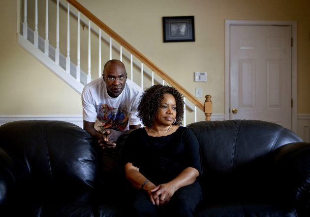 <p>               Michael, left, and Patricia Jackson are photographed in their home Saturday, June 16, 2012, in Marietta, Ga. On a suburban cul-de-sac northwest of Atlanta, the Jacksons are struggling to keep a house worth $100,000 less than they owe. Their voices and those of many others tell the story of a country that, for all the economic turmoil of the past few years, continues to believe things will get better. But until it does, families are trying to hang on to what they've got left. The Great Recession claimed nearly 40 percent of Americans' wealth, the Federal Reserve reported last week. The new figures, showing Americans' net worth has plunged back to what it was in 1992, left economists shuddering. (AP Photo/David Goldman)
