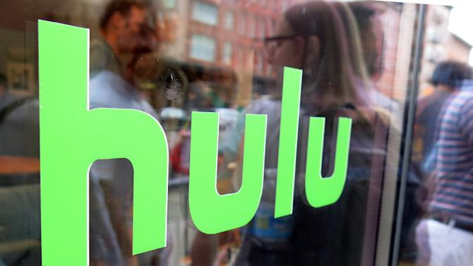 "This Saturday, June 27, 2015 photo shows the Hulu logo on a window at the Milk Studios space in New York, where a replica of the ""Seinfeld"" set was on display, in New York. The cable network Epix jumped from Netflix to Hulu, the companies announced late Sunday, Aug. 30, 2015, landing a multiyear, digital subscription video on demand deal with the streaming service. (AP Photo/Dan Goodman)"