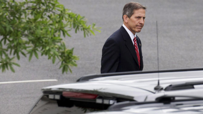 Deputy Veterans Affairs Secretary Sloan Gibson leaves the White House in Washington, Friday, May 30, 2014, after being named by President Barack Obama to run the Veterans Affairs Department on an interim basis while Obama searches for a replacement for Veterans Affairs Secretary Eric Shinseki who resigned Friday. (AP Photo/Jacquelyn Martin)