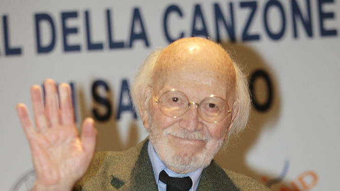 """FILE -- In this file photo taken at the Sanremo song festival on March 2, 2007, Italian composer Armando Trovajoli waves during a photo call. Trovajoli, who composed music for some 300 films and wrote a serenade to Rome popular with tourists, has died in Rome at age 95. Among Trovajoli's hits was """"Roma nun fa' la stupida stasera,"""" a romantic melody played for visitors to Rome. He composed scores for Italian hit movies including """"A Special Day"""" and """"Two Women,"""" starring Sophia Loren, and the neorealism classic """"Riso Amaro."""" A pianist, he played alongside such jazz greats as Miles Davis, Duke Ellington and Chet Baker. (AP Photo/Luca Bruno)"""