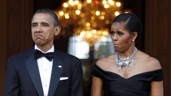 U.S. President Obama and first lady Michelle Obama react as car carrying Queen Elizabeth arrives in London