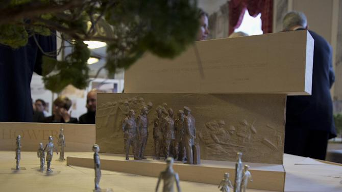 A portion of a model of  a memorial honoring Dwight D. Eisenhower is seen during a public meeting of the Eisenhower Memorial Commission on Capitol Hill in Washington, Wednesday, June 19, 2013, to discuss the continued controversy over Frank Gehry's design. Gehry is changing some elements of his design for a memorial honoring President Dwight D. Eisenhower in Washington as memorial planners move toward seeking approvals to build the project. (AP Photo/Carolyn Kaster)