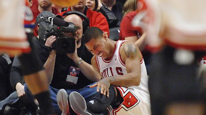 Chicago Bulls point guard Derrick Rose reats after injuring his leg in the fourth quarter of Game 1 in the first round of the NBA basketball playoffs against the Philadelphia 76ers Saturday, April 28, 2012, in Chicago. The Bulls won 103-91. (AP Photo/Daily Herald, John Starks) MANDATORY CREDIT; TV OUT; MAGS OUT