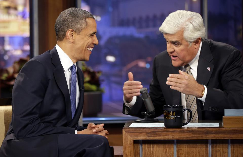 President Barack Obama talks with Jay Leno, right, during a commercial break during the taping of his appearance on NBC's The Tonight Show with Jay Leno, Wednesday, Oct. 24, 2012, in Burbank, Calif. (AP Photo/Pablo Martinez Monsivais)