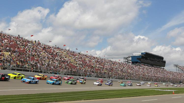 Sprint Cup Series driver Kurt Busch (78) leads the field during the NASCAR Quicken Loans 400 auto race at Michigan International Speedway, Sunday, June 16, 2013 in Brooklyn, Mich. (AP Photo/Carlos Osorio)