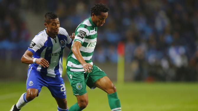Porto's Sandro fights for the ball with Sporting's Carrilo during their Portuguese Premier League soccer match at Dragao stadium in Porto