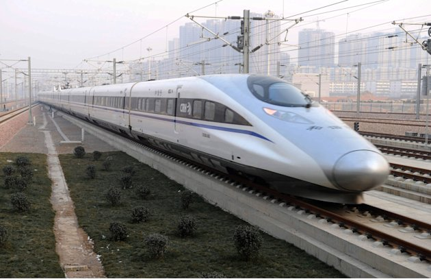 In this photo released by China's Xinhua news agency, a high-speed train G802 leaves for Beijing from Shijiazhuang, capital of north China's Hebei Province, Wednesday, Dec. 26, 2012. China has opened 