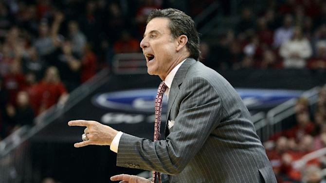 FILE - In this Jan. 28, 2013, file photo, Louisville head coach Rick Pitino instructs his team during the second half of their NCAA college basketball game against Pittsburgh in Louisville, Ky. The Cardinals have shown that they are comfortable being front-runners in their season-long quest to go farther than last year's Final Four appearance. Now, they enter the NCAA tournament as the overall No 1 seed. (AP Photo/Timothy D. Easley, File)