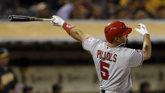 Los Angeles Angels' Albert Pujols (5) hits a solo home run against the Oakland Athletics during the seventh inning of a baseball game on Monday, April 29, 2013 in Oakland. Calif. (AP Photo/Marcio Jose Sanchez)