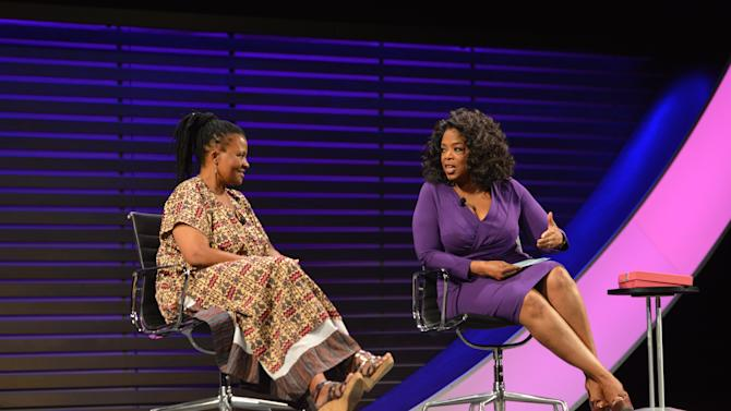 "This image released by the  Women in the World Conference  shows scholar, humanitarian and founder of the Tinogona Foundation Dr. Tererai Trent, left, OWN CEO Oprah Winfrey, during a panel discussion called ""Oprah: Meet My Hero,"" at the 2013 Women in the World Summit in New York. (AP Photo/Women in the World Conference, Marc Bryan-Brown)"