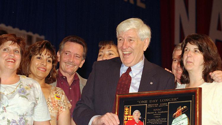 FILE - In this Monday, July 27, 1998 file photo, Vincent Sombrotto, president of the National Association of Letter Carriers, holding plaque, reacts after receiving the plaque honoring him for his support of the hotel and restaurant union employees who were on strike at the Frontier Hotel and Casino, during the Nastional Association of Letter Carriers convention, in Las Vegas. Surrounding Sombrotto are some of the union members who were on strike at the Frontier which ended on Jan. 31, 1998, after more than six years. Sombrotto, who served as president of the National Association of Letter Carriers for 24 years, died Thursday, Jan. 10, 2013, at age 89. (AP Photo/Lennox McLendon, File)