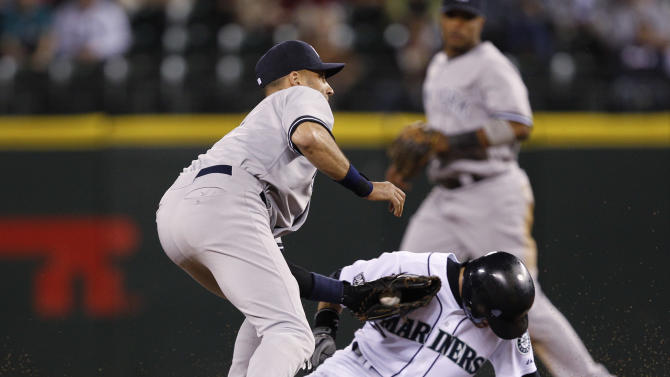New York Yankees shortstop Derek Jeter, left, tags out Seattle Mariners' Ichiro Suzuki on a stolen base attempt at second base in the ninth inning to end a baseball game Tuesday, Sept. 13, 2011, in Seattle. The Yankees won 3-2. Pitcher Mariano Rivera earned his 600th save, moving within one of Trevor Hoffman's major league record, by closing out the New York Yankees' 3-2 win over the Seattle Mariners on Tuesday night. (AP Photo/Elaine Thompson)