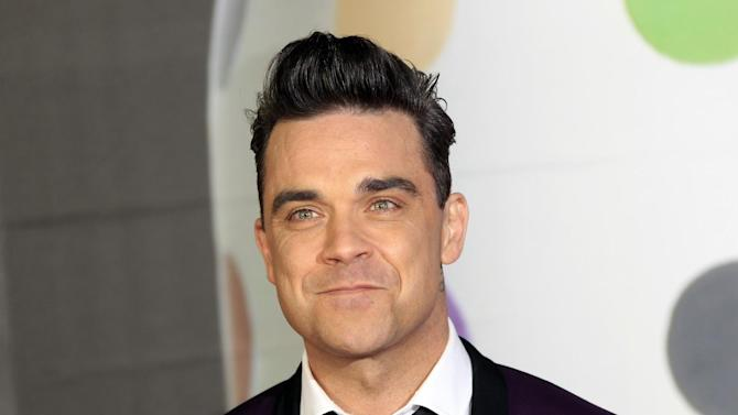 Robbie Williams seen arriving at the BRIT Awards 2013 at the o2 Arena in London on Wednesday, Feb. 20, 2013. (Photo by Joel Ryan/Invision/AP)