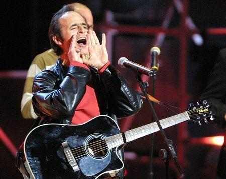 French singer Jean-Jacques Goldman jokes about an electrical failure during his performance at the N..