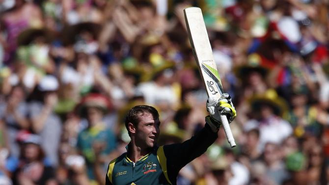 File photo of Australia's Phil Hughes celebrating reaching his century during the one-day international cricket match against Sri Lanka at the Melbourne Cricket Ground