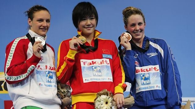 Silver medallist Katinka Hosszu of Hungary, gold medallist Shiwen Ye of China and bronze medallist Hannah Miley of Britain pose with their medals during the awards ceremony for the women's 200m individual medley final during the FINA World Swimming Champi