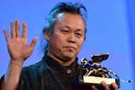 Korean film director Kim Ki-Duk holds the Golden Lion for best movie during the award ceremony of the 69th Venice Film Festival. Kim&#39;s morality tale &quot;Pieta&quot; won