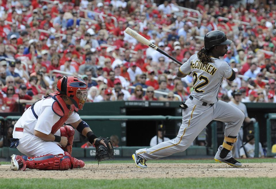 Pittsburgh Pirates' Andrew McCutchen (22) hits a one-run single which scored Jeff Karstens during the sixth inning of a baseball game against the St. Louis Cardinals, Sunday, Aug. 19, 2012, in St. Louis. (AP Photo/Jeff Curry)
