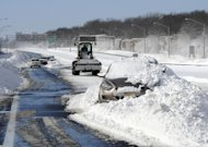 FILE - This Feb. 9, 2013 file photo shows abandoned cars on the Long Island Expressway after a snow storm in Islandia, N.Y. New York state has suspended two Transportation Department officials amid criticism of the snow-removal effort on eastern Long Island. An attorney for one of the officials confirmed Thursday, Feb. 14, 2013 the suspensions are for 30 days without pay. (AP Photo/Kathy Kmonicek, file)