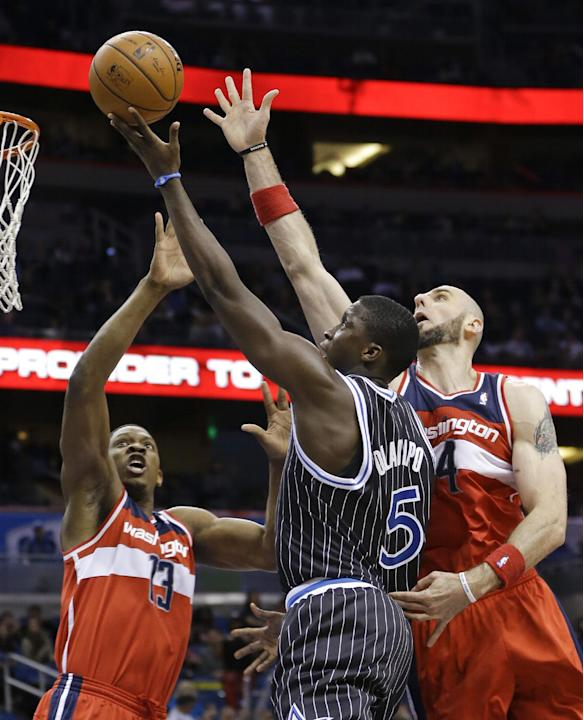 Orlando Magic's Victor Oladipo (5) takes shot as Washington Wizards'  Bradley Beal (3) and Marcin Gortat, right, defend during the second half of an NBA basketball game in Orlando, Fla., Frida