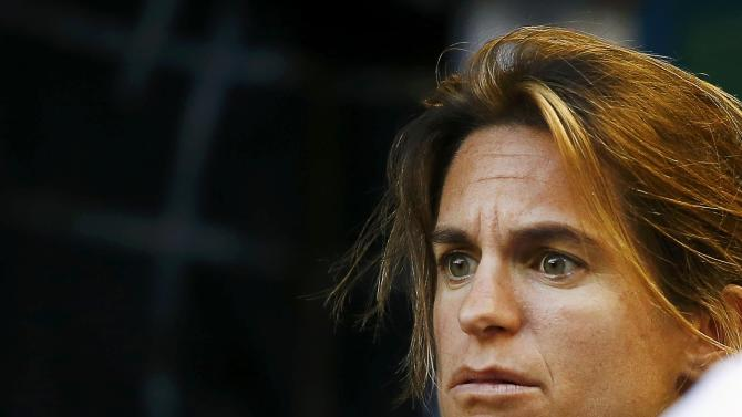 Mauresmo, coach of Murray of Britain, watches as he plays Berdych of Czech Republic in their men's singles semi-final match at the Australian Open 2015 tennis tournament in Melbourne