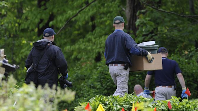 Law enforcement agents search the back yard of reputed Connecticut mobster Robert Gentile in Manchester, Conn., Thursday, May 10, 2012.  Gentile's lawyer A. Ryan McGuigan says the FBI warrant allows the use of ground-penetrating radar and believes they are looking for paintings stolen from Boston's Isabella Stewart Gardener Museum worth half a billion dollars. (AP Photo/Jessica Hill)