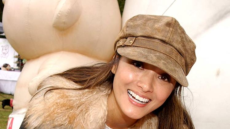 Kelly Hu and dog