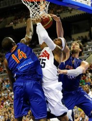 Carmelo Anthony of the US Men's Senior National Team, center, competes for the ball against Serge Ibaka of the Spain Men's Senior National Team, left, and Pau Gasol during an exhibition match between Spain and the United States Tuesday, July 24, 2012, in Barcelona, Spain, in preparation for the 2012 Summer Olympics. (AP Photo/Manu Fernandez)