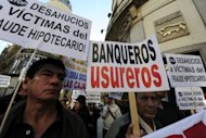<p>A demonstration against banks in Madrid on Monday. Spain's public debt soared to a record 68.5 percent of economic output at the end of 2011, Bank of Spain figures showed Friday.</p>