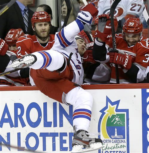 Rangers claim playoff spot by beating Canes 4-3