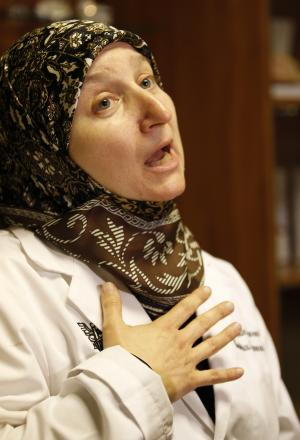 Lebanese Dr. Iman Sharara speaks to journalists in her clinic, south of Beirut, Lebanon, Wednesday, Oct. 27, 2010. Sharara says dozens of women have stormed her clinic as international investigators were visiting her, asking for some of her patients telephone numbers. Police and witnesses say more than a dozen women have scuffled with U.N. investigators and chased them out of a Beirut clinic as they tried to conduct interviews connected to the 2005 assassination of a former prime minister. Police and witnesses said the women pulled the hair of a U.N. translator and stole a briefcase from the investigators. The Hague-based court said in an e-mail that they are taking the incident seriously. (AP Photo/Hussein Malla)
