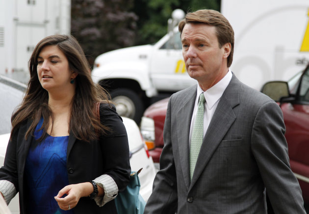 Cate Edwards walks with her father John Edwards into the federal courthouse in Greensboro, N.C., as the defense continues in John Edwards' campaign corruption trial Monday, May 14, 2012. (AP Photo/Bob Leverone)