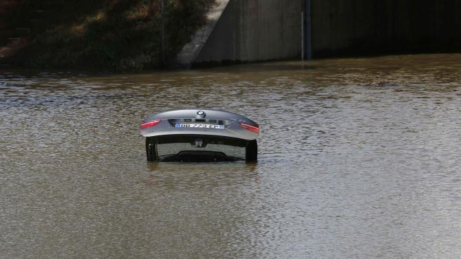 An abandoned car is submerged in deep water near by an underpass by the autoroute after flooding caused by torrential rain in Mandelieu