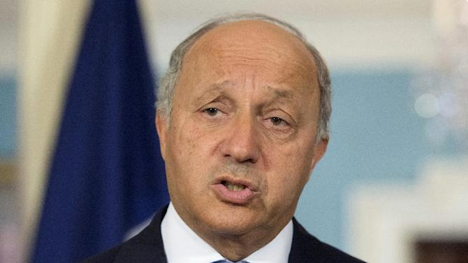 French Foreign Minister Laurent Fabius speaks to the media before his meeting with Secretary of State John Kerry at the State Department in Washington, Tuesday, May 13, 2014. (AP Photo/Molly Riley)