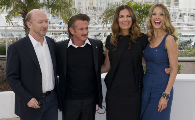From left, filmmaker Paul Haggis, actors Sean Penn, Roberta Armani and model Petra Nemcova pose during a photo call for the Haiti Carnival charity event at the 65th international film festival, in Cannes, southern France, Friday, May 18, 2012. (AP Photo/Jonathan Short)