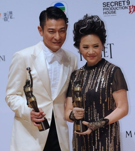 Hong Kong actors Deanie Ip (R) and Andy Lau on after winning awards for their roles in the film &quot;A Simple Life&quot;